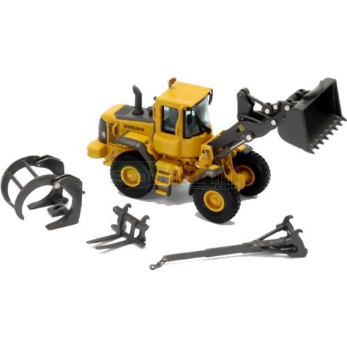13094: Volvo L60E Wheel Loader With Attachment Set
